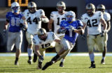 Air Force's Chad Hall cuts left as Army defensive back Jordan Murray can't make a diving tackle...