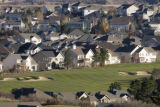 DM0012   Houses line a fairway at The Ridge golf course in Castle Pines North, Colo. Wed. Nov. 7,...