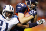 CODZ102 - Tennessee Titans cornerback Reynaldo Hill, left, tries to knock the ball out of the...