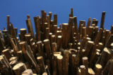 Stacks of pine trees log, rest in the yard of Confluence Energy's new facility, Highway 9,...