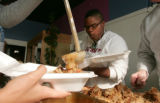 Ailey Pope (cq) 17,  joins in as volunteers spend their Thanksgiving , giving by volunteering to...