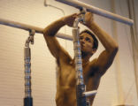**SPCL TO ROCKY MOUNTAIN NEWS** Gymnast Guillermo Alvarez adjusts parallel bars at practice at...