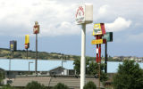 Some of the dozen high visibility signs near the Wolfensberger I-25 exit in Castle Rock August 15,...