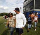 Denver Broncos John Lynch escorts Rosalind Williams to the field after practice at Valley Ranch on...
