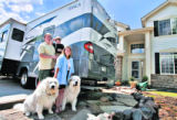 Eric Brandaw with his wife Tracy and son Colin  outside their Winnebago parked in the driveway of...