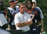 The Denver Broncos head coach Mike Shanahan concerned watching as linebacker Warrick Holdman, is...