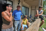 Jennifer Elder (cq) stands her back porch with husband Duane Clark (cq) and sons Logan Kelly (cq)...
