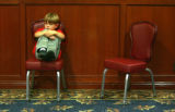 Joseph Van Dusen (cq), 6, of Colorado Springs, sits in a chair as the group does an exercise where...