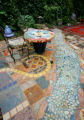 Abbas Khajeaian's mosaic work in his backyard in east Denver on July 20, 2007.  He and his...