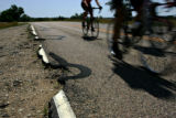 Cyclists ride along dilapidated roads at Cherry Creek Lake State Recreation Area in Englewood,...