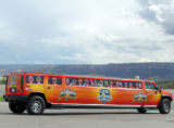 A Limo with Power Rangers Characters on the windows travels through Grand Junction Saturday from...