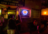 A crowd gathers outside of the 12-VOLT TAVERN on Friday evening August 10, 2007. The 12-VOLT...