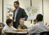 0146 Jaime Aquino, chief academic officer for the Denver Public Schools, taps Ryan Greska, CQ, 11,...