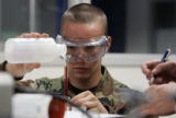 Freshman Air Force Cadet 4th class C.J. Cole works on a lab to figure out what an alien substance...