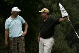 Loel Lierman (cq), of Parker, Colo., right, caddies for Chaparral High School senior Branden...