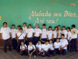 STRANAHAN_HONDURAS---Wearing Flying Dog Brewery t-shirts, children in a class pose for a picture...
