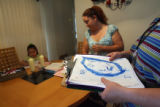 Preschool teacher Stephanie Peterson (cq) (far right) holds a portrait of her that 4 year-old...
