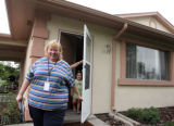 Preschool teacher Stephanie Peterson (cq) leaves the Trujillo residence in Commerce city after she...