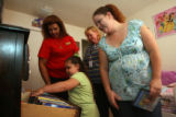 (from left) Linda Ortega (Cq) watches 4 year-old Isabella Vergil's (cq) movies, at her room in her...