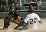 Cherokee Trail player Albernice Drayton slides safely into home before the tag by Cheyenn Mountain...