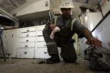 Jay Williams (cq) of Ft. Lupton inspects a drill bit used to drill a hole 7500 feet deep in Weld...