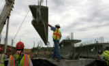 Dominic Moncayo, cq, guides a 72,040 lbs girder in to place for installation at the Turkey Creek...