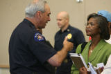 Aurora Police chief Dan Oates, cq,  speaks with Loree McCormick-Rice, cq, Tuesday, August 7, after...