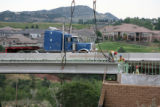 A 72,040 lbs girder is installed at the Turkey Creek Rd bridge, Tuesday Aug. 7, 2007. Six were...