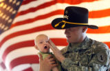 Private First Class Lucas Leach (cq), age 20, holds his 3 month-old son Damian Leach (Cq) at the...