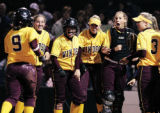 Windsor junior Mallory Duran (9) meets her teammates at home plate after hitting a two run home...