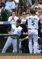 Rockies manger Clint Hurdle celebrates Matt Holiday scoring on a Garrett Atkins double in the...