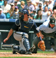 Rockies Todd Helton, not in photo, slides safe at home while Brewers catcher Damian Miller, looks...