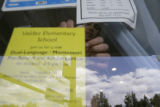 Newly hired principal of Valdez Elementary school Peter Sherman(cq), hangs a flyer advertising his...