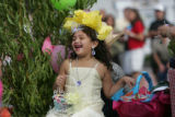 Leslie Arevalo, 6, is dressed as a peach flower in the Palisade Peach Festival Parade on the float...