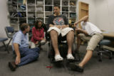 (JOE0625) - Tommy Urbanski, in black shirt, has his electric wheelchair adjusted by DME consultant...