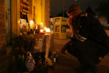 DLM0187  Jose Jacquez kneels in front of a memorial for his friend Joshua Trobaugh in front of...