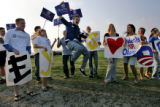 James Schulke (CQ),22, of Davis, Calif., leaps in the air to lead supporters for Democratic...