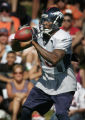 (JOE0126) - Denver Broncos wide receiver Brandon Marshall carries the ball during his first...