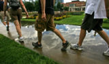 The Denver sky is reflected in a puddle left by an afternoon storms, at Civic Center Park, August...