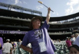 Jim Clark (CQ) of Grand Junction, Colo., waves a broom in the air at the conclusion of the...