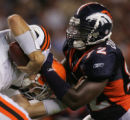 WEB CAPTION:   Broncos Elvis Dumervil (92) sacks Browns quarterback Derek Anderson in the first...