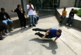 Matt Marshall (cq), 23, of Denver, shows off some of his break-dancing skills while practicing...