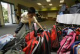 Johan Vizcarra, 5, reaches out for a new backpack at the Denver Zoo on Sunday, Aug. 12, 2007.  300...