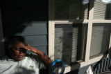 58 year-old Loradale Smith (cq) relaxes at her porch at the Curtis Park Villages in Denver....