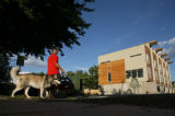 Mark Stabrawa (cq) walks his dog at the opposite corner where a high-end apartment complex is...