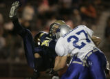 [(Thornton, CO,Shot on: 9/17/04)]  Legacy High School Justin Little gets flipped upside down by...