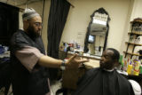 Abdul Karim (cq), co-owner of the Hyde Park Hair Salon located in the Hyde Park neighborhood just...