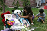 Tanaria Manriquez, 6, looks at a photo of her cousin, Jasmine Hernandez, 8, Tuesday Aug. 28, 2007...