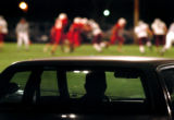 (DENVER, Co., SHOT 9/24/2004) Pickup trucks and cars encircle the field as fans from both sides of...