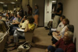 The City Council Chamber in Longmont were packed, with people crowding doorways and sitting on the...